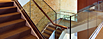 "System: CRL's GRS TAPER-LOC® Glass Railing System with 1-1/2"" Heavy Wall Brushed Stainless Steel Hand Rail"